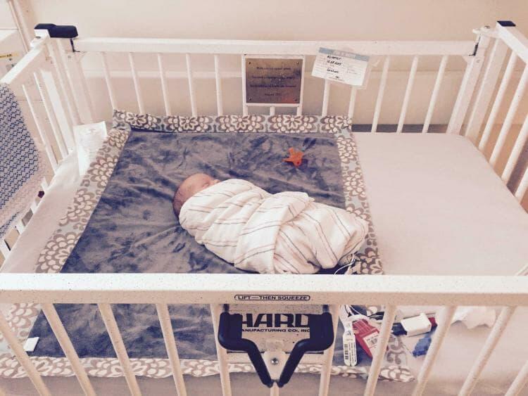 Preemie Lucas sleeping swaddled in NICU