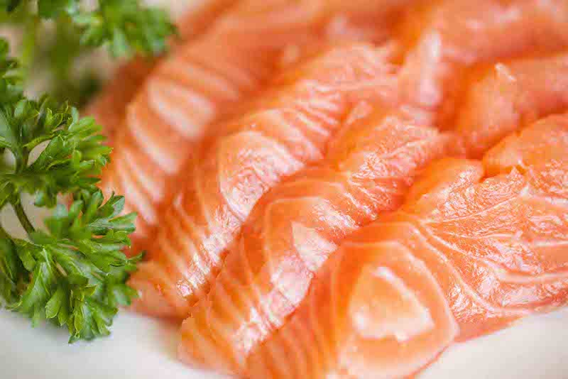 How healthy is farmed salmon and what is ethoxyquin?