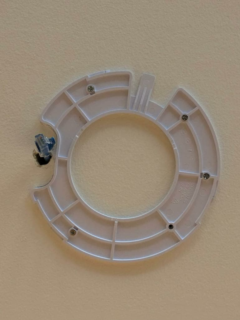 UniFi AP mounting bracket on the ceiling