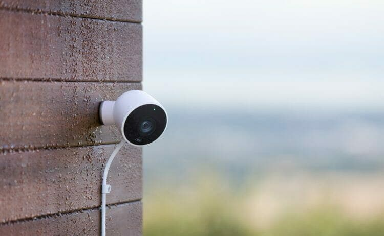 Nest Outdoor Cam mounted on brick wall