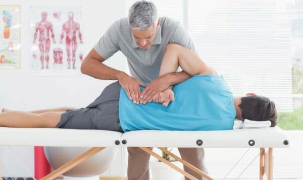 Chiropractor adjusting a patient's spine