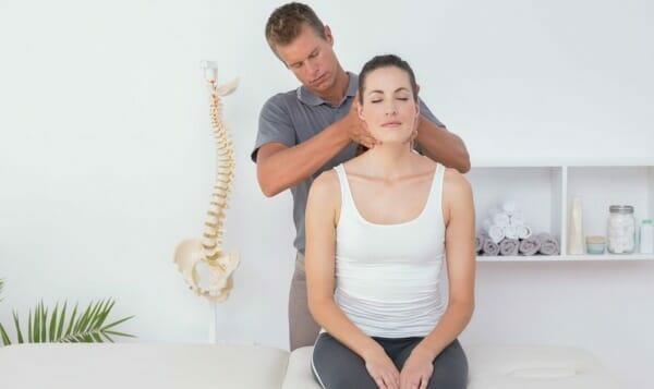 Chiropractor adjusting patient's neck
