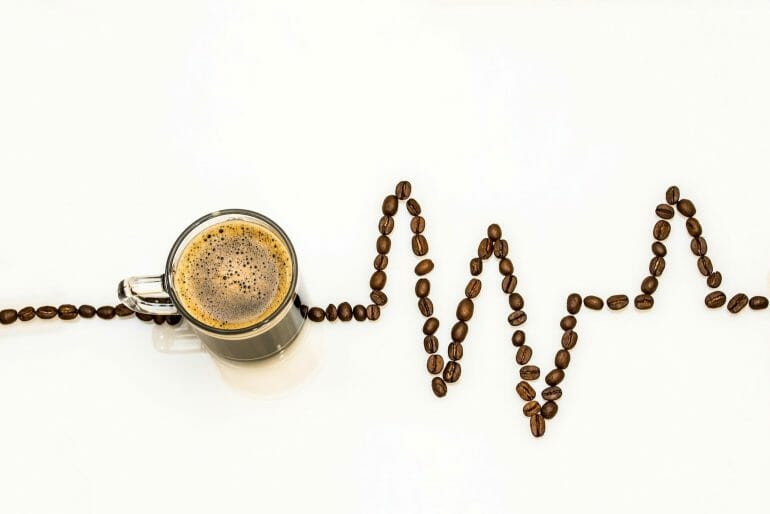 Caffeine acts as a stimulant to improve workout performance