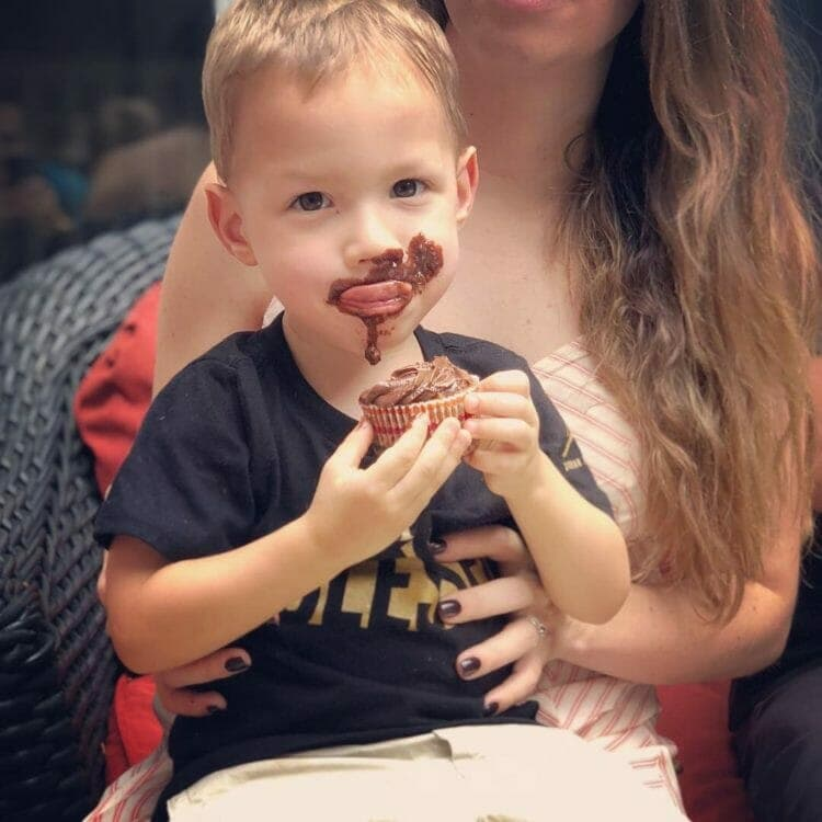 Eating healthy doesn't mean no treats. Here Lucas enjoys a Paleo cupcake