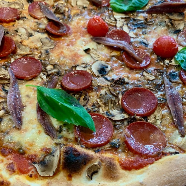 Classic pizza with gluten and everything else you shouldn't have (on a regular basis)
