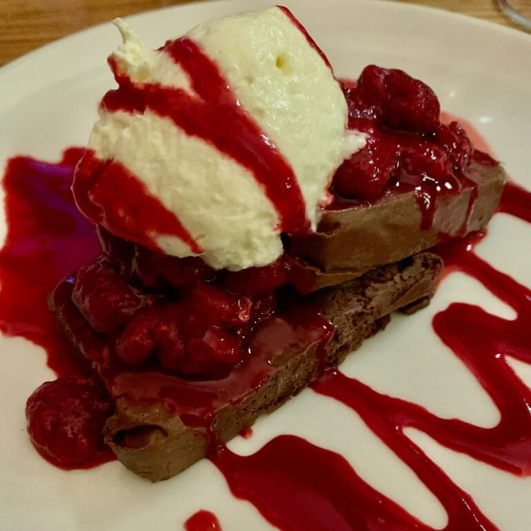 Flourless chocolate tart with plenty of sugar and vanilla ice cream