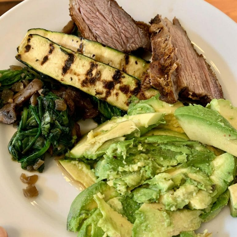 Brisket with grilled zucchini, avocado, spinach and mushrooms