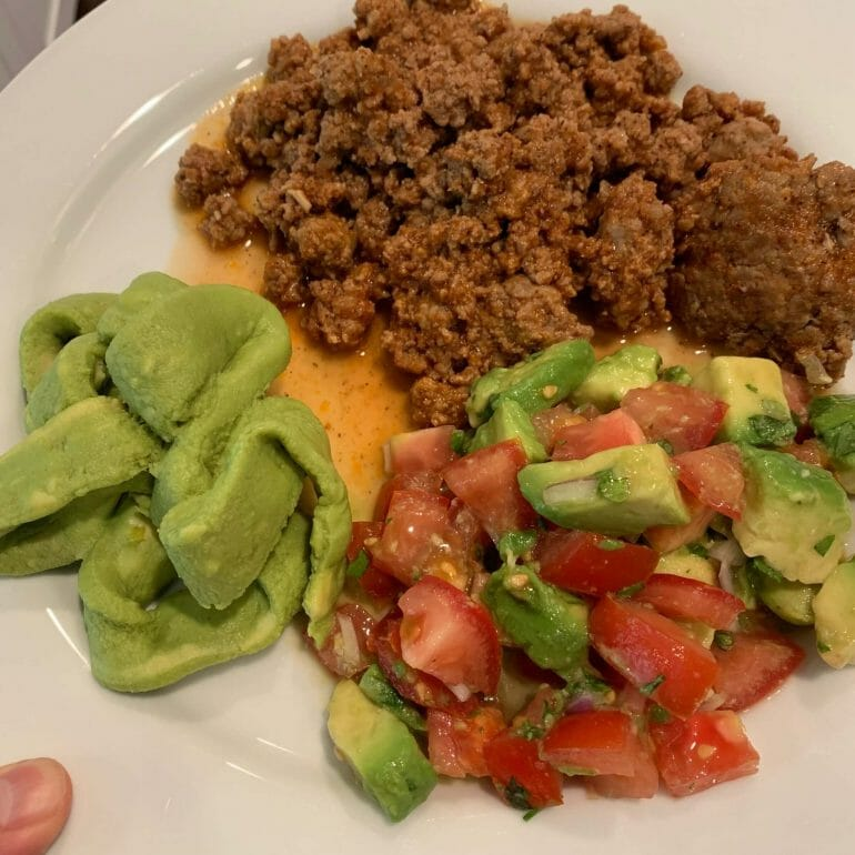 Ground meat with guacamole and avocado/tomato salad