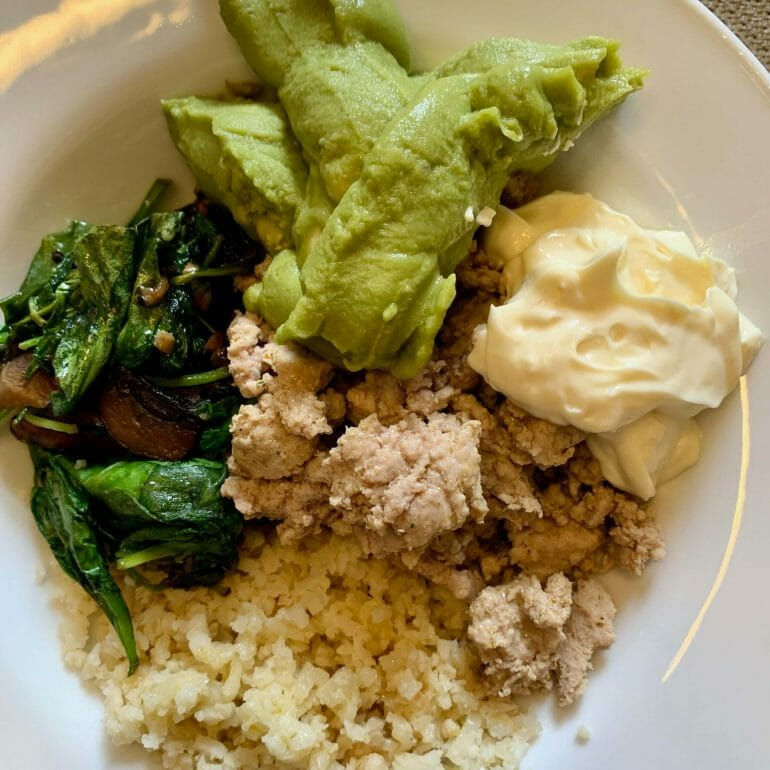 Ground turkey, riced cauliflower, spinach and mushrooms. Topped with mayo and guacamole