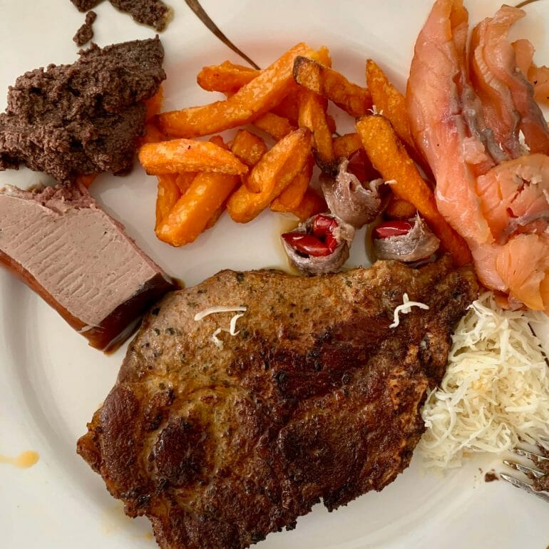 Pork, sweet potato fries, smoked salmon, horse radish, olive paste, anchovies and pate