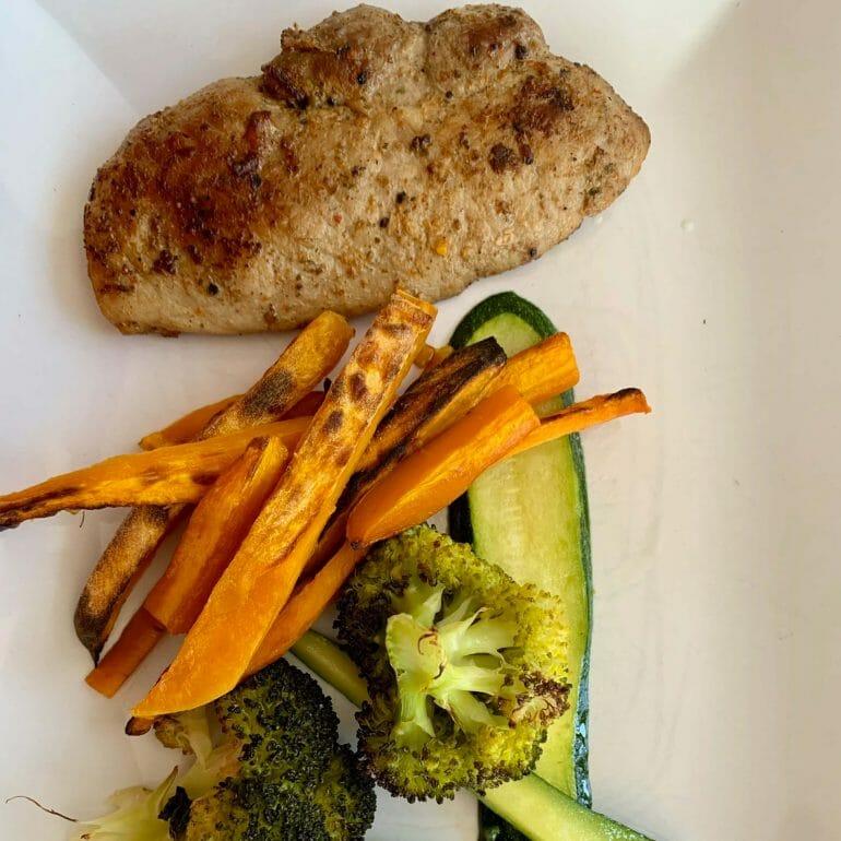 Pork with broccoli, zucchini and sweet potato fries