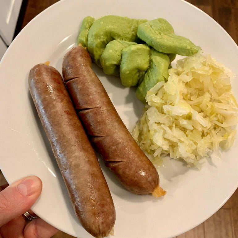 Beef sausages with sauerkraut and guacamole