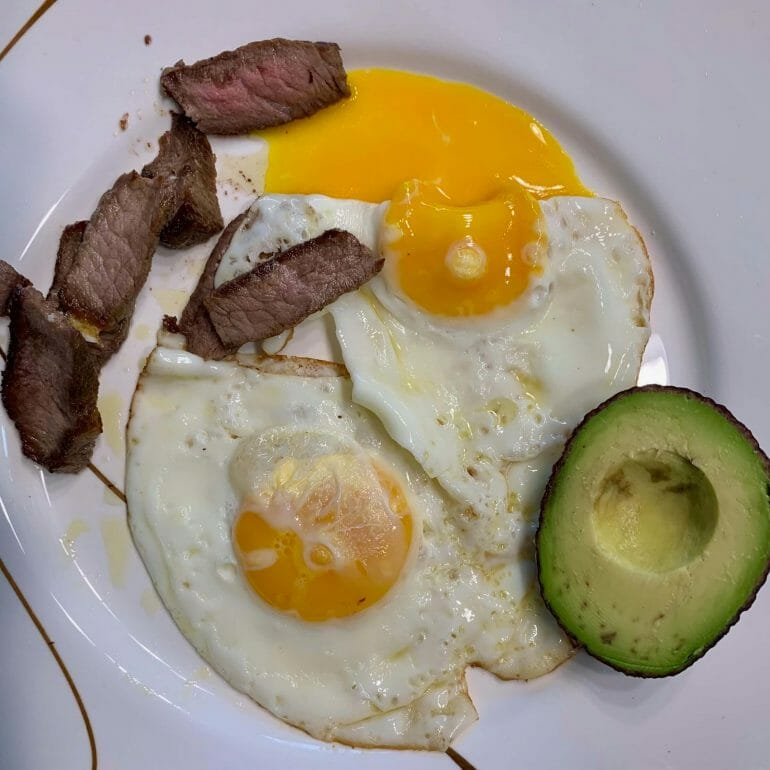 Fried eggs, steak and avocado