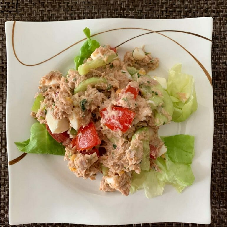 Tuna salad with mayo, eggs, tomatoes, cucumbers and lettuce