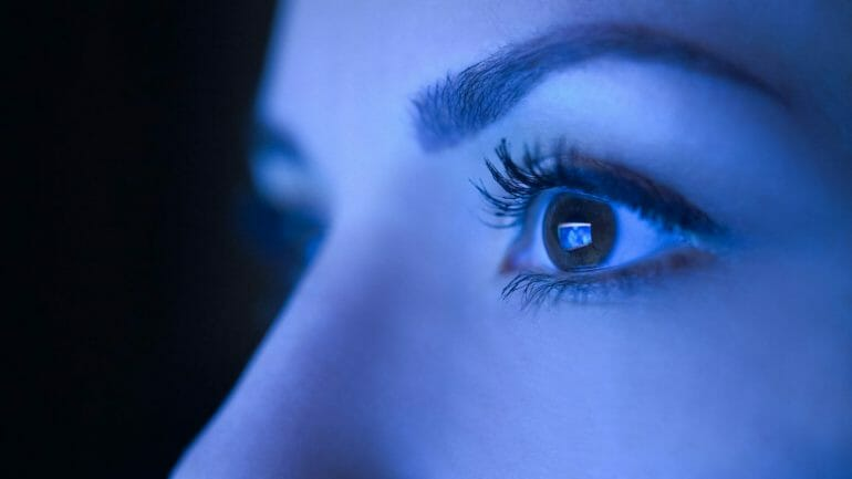 Blue light hitting a woman's eye