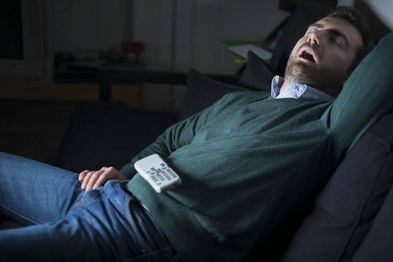 Man sleepy on couch