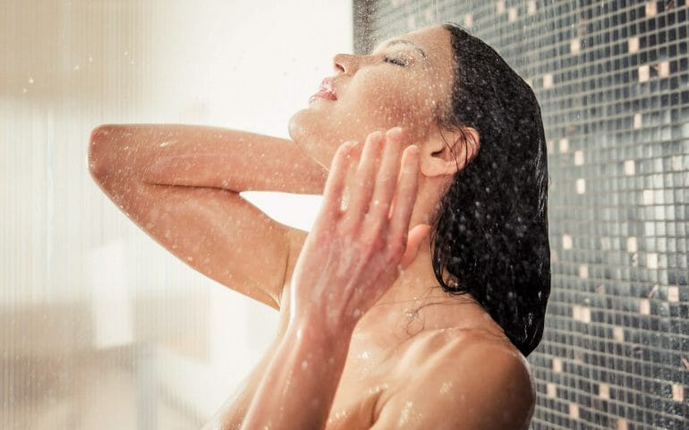 Woman taking a hot shower