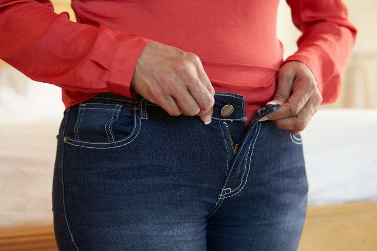Woman who cannot close her pants.