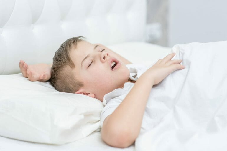 Boy sleeping with mouth open