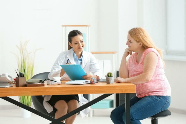 Obese woman consulting with dietitian