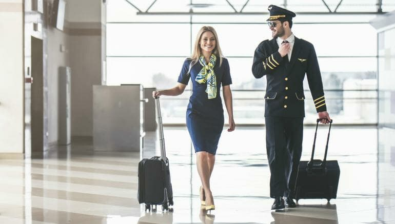 Pilot and flight attendant at airport