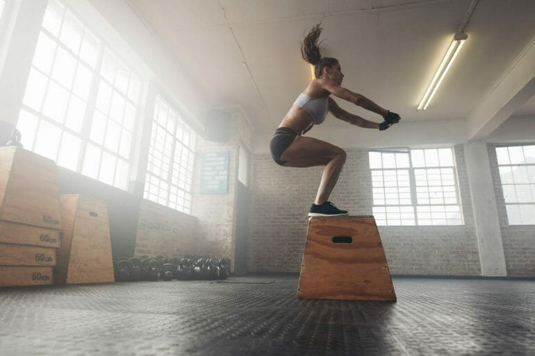 Woman doing box jumps