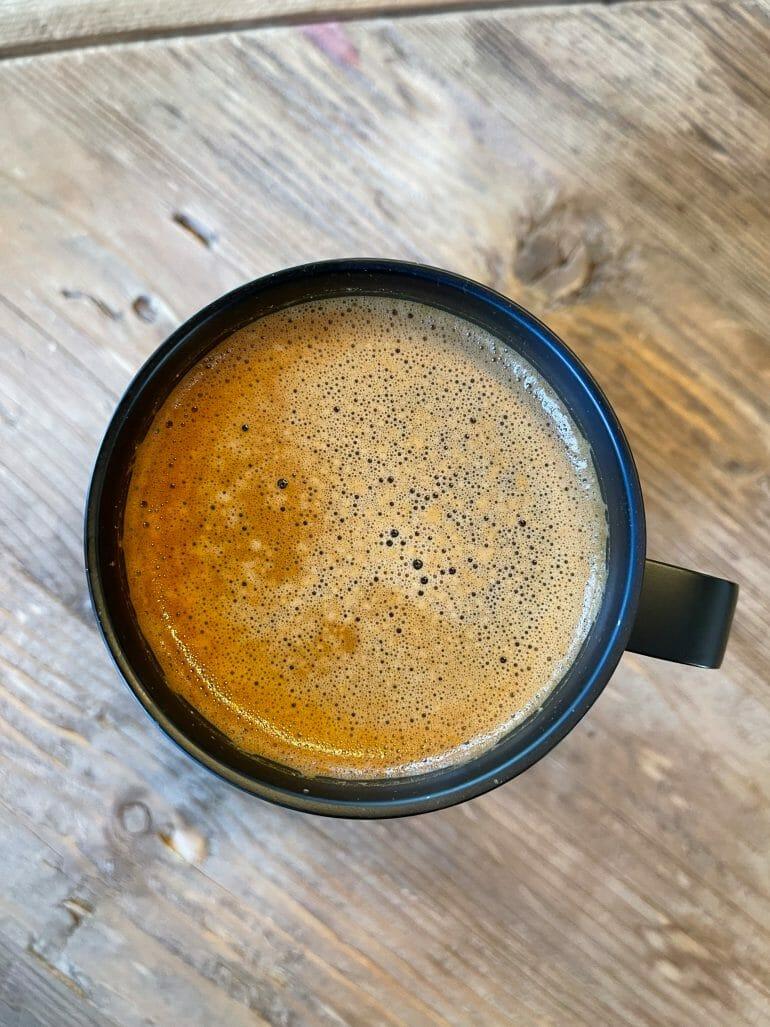 A top view of a mug full of MUD\WTR.