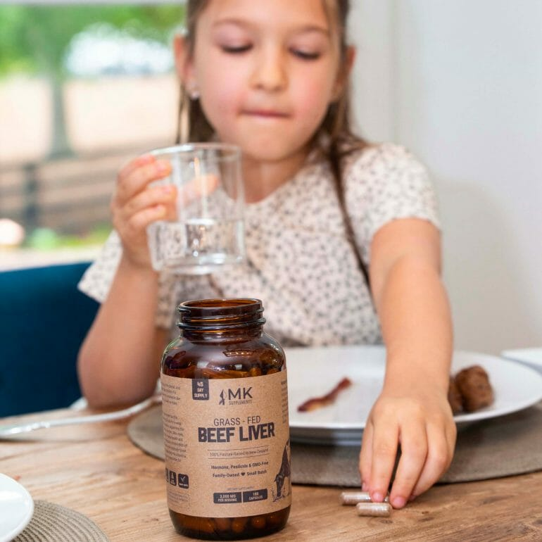 My daughter, Isabella, getting ready to take some beef liver supplements.