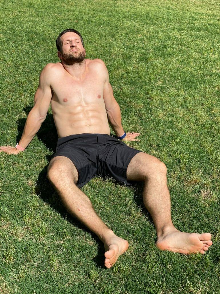 A photo of Michael Kummer sunning shirtless in the backyard.