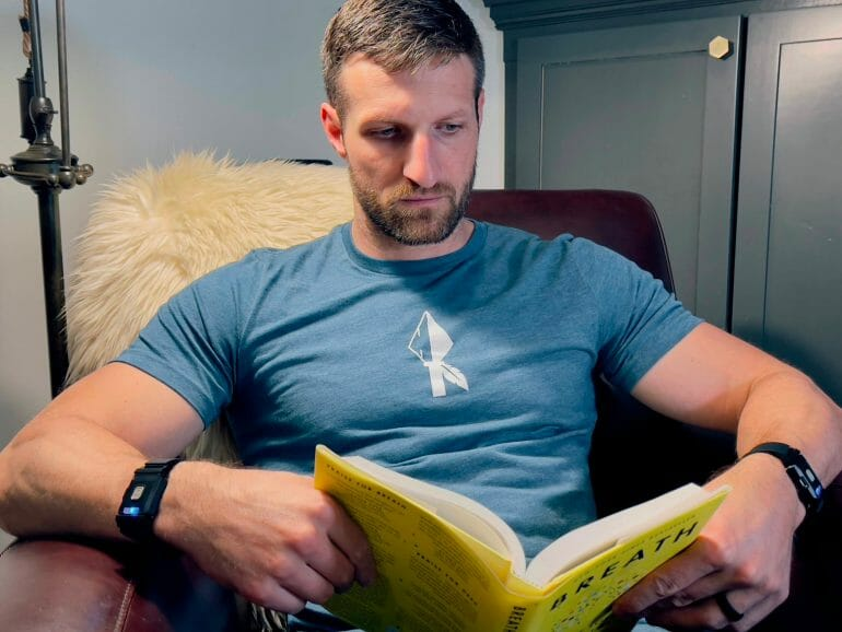 Michael wearing TouchPoints and reading a book.