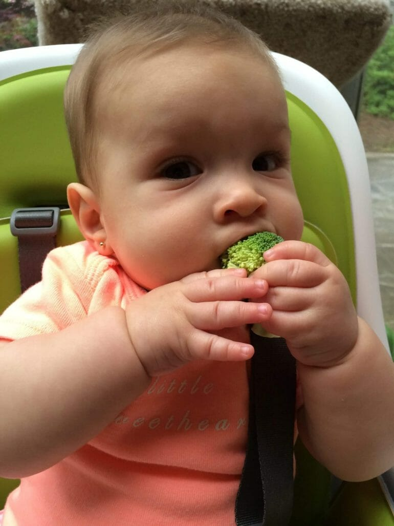 Michael's daughter Isabella eating broccoli for the first time.